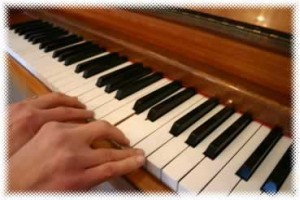 Fingers on the edge of piano notes