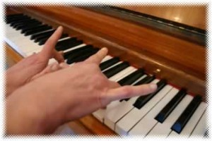fingers flying off piano notes